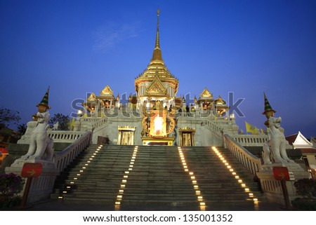 Wat Traimit entrance at dusk in Bangkok, Thailand.  Traimit temple, located near China town, is built in 1832 by three Chinese donors. - stock photo