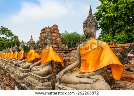 Wat yai chai mongkhol is a Buddhist temple in Ayutthaya, Thailand. It is situated to the southeast of the city. The large chedi there can be seen from a great distance. - stock photo