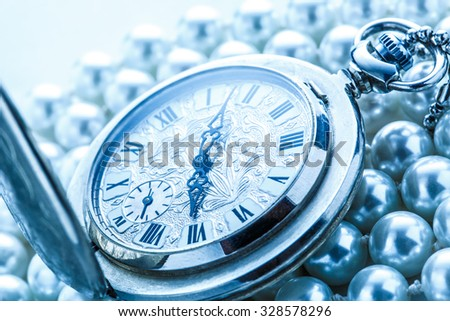 Watch in closeup on pearl background in cold colour  - stock photo