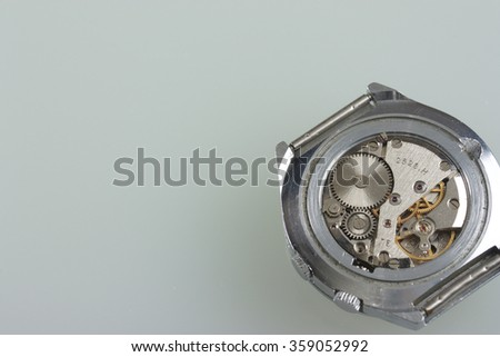 Watch machinery macro details. Time within. Old watch with no caps. Clockwork. - stock photo