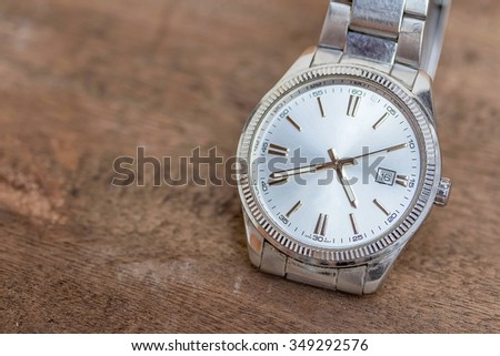 watch on a wooden floor - stock photo
