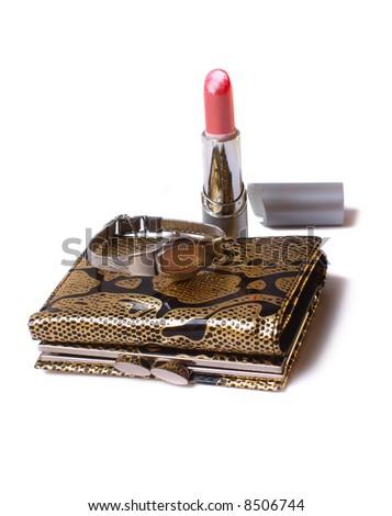 watch on purse and lipstick - stock photo
