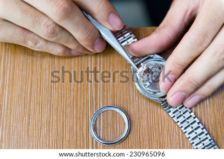Watch repair in the workshop. - stock photo
