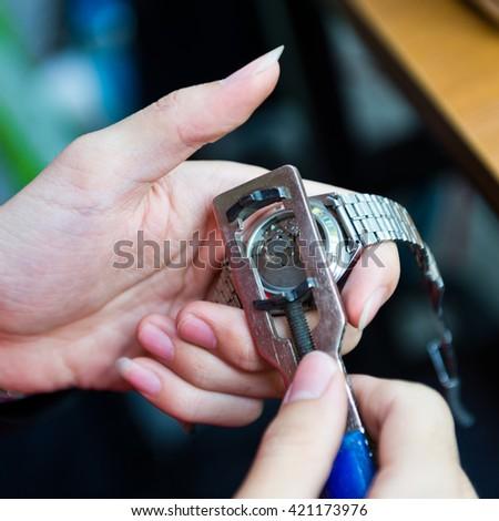 Watch repair in the workshop. - stock photo