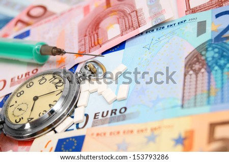 Watch, tablets and a syringe for euro banknotes - stock photo
