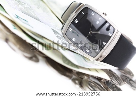 Watch with money. Financial concept on white background.