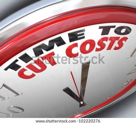 Watch your spending and reduce your overhead by paying attention to this clock telling you it is Time to Cut Costs and get your budget in order before you are in debt or bankrupt - stock photo
