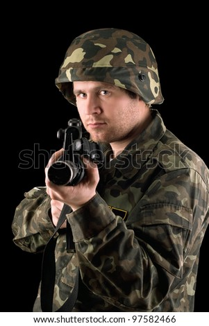 Watchful soldier with m16 in the hands - stock photo