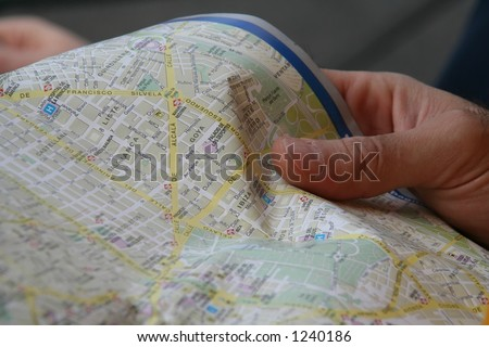 watching a touristic map #1 - stock photo