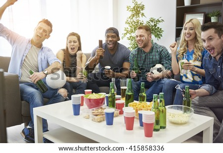 Watching soccer is their common hobby - stock photo
