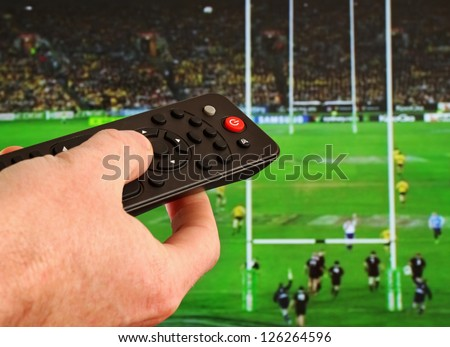 Watching Sport on TV - stock photo