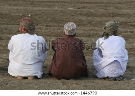 Watching the bullfighting, Oman - stock photo