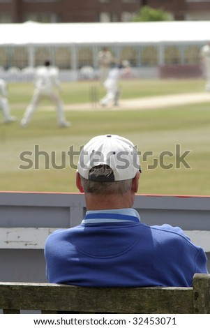 Watching the cricket - stock photo