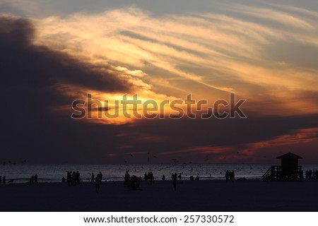 Watching the Sun Set Over the Intracoastal From Madeira Beach, Florida. - stock photo
