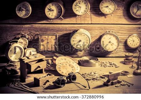 Watchmaker's workshop full of clocks - stock photo