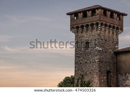 Watchtower of castle at sunset in Italy
