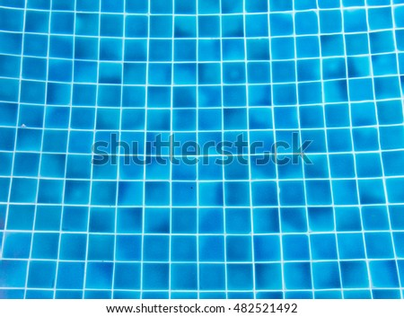 water and blue ceramic floor of pool