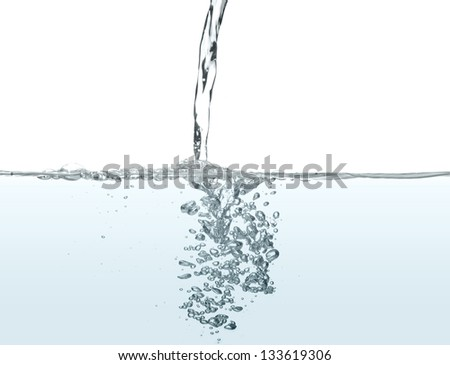 Water been poured into more water, making bubbles - stock photo