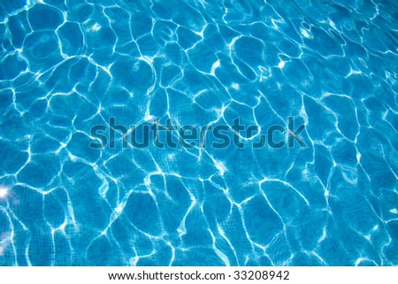Water blue transparent texture from a swimming pool - stock photo