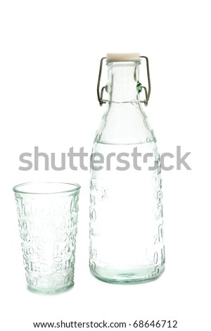 Water bottle and glass - stock photo