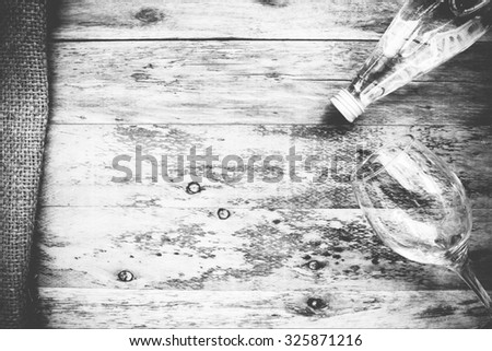 water bottle and glass on the wooden table, Black & White - stock photo