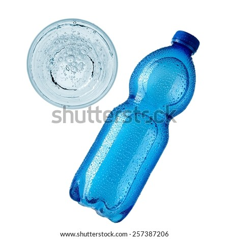 Water bottle and glass, top view - stock photo
