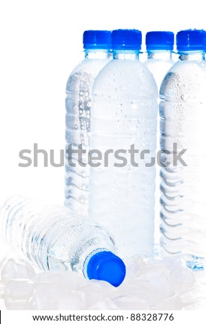 Water bottles on ice over white background