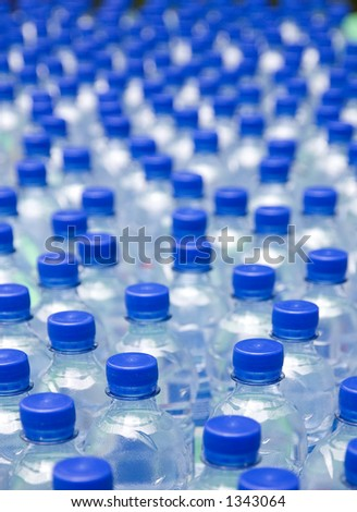 Water bottles with blue cups, shallow DOF.