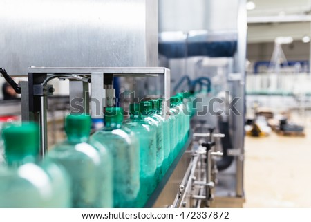 Water bottling line for processing and bottling pure mineral carbonated water into bottles. Selective focus