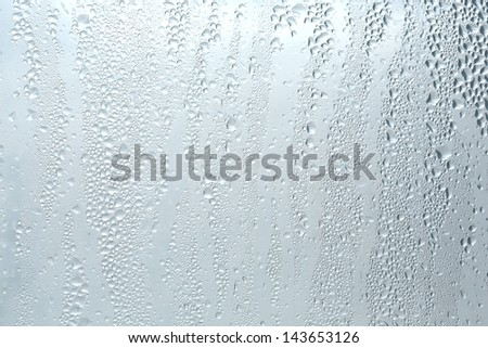 water bubbles on a window. - stock photo