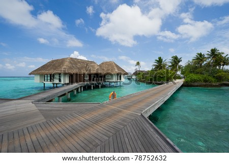 water bungalows in maldives resort - stock photo