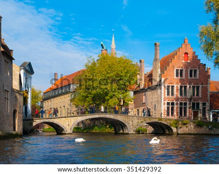 Water canal with old bridge and medieval houses of Bruges, Belgium - stock photo