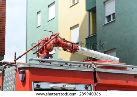 Water cannon on fire-fighting truck roof - stock photo