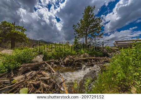 Water cascad on a small mountain creek in the Rockies Colorado - stock photo