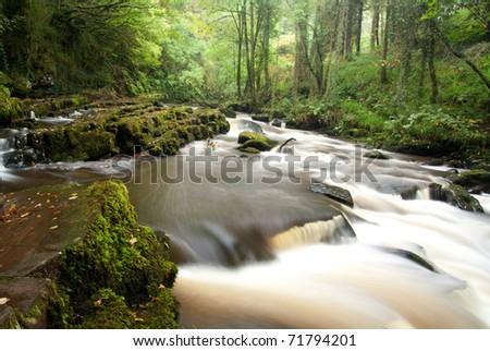 Water cascade in Ireland - stock photo