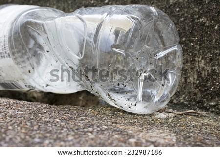 Water clear Plastic button trash on the road. - stock photo
