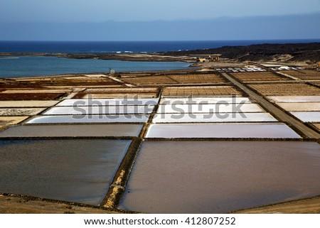 water coastline salt in  lanzarote spain musk pond rock stone sky     and summer  - stock photo