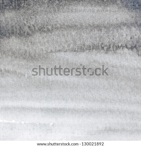 Water color paint in black background. - stock photo