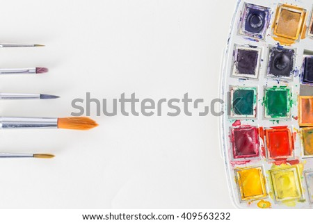 Water colors and brush - stock photo