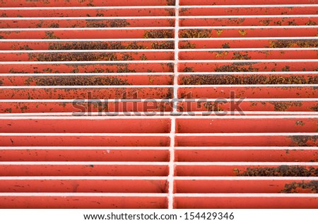 Water drain grill in a path fragment - stock photo