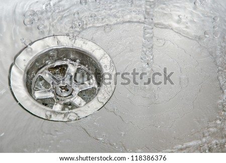 Water drain kitchen - stock photo