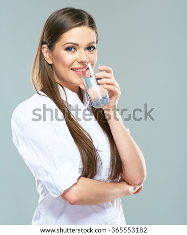 Water drink. Smiling woman with water glass. Isolated portrait of young business woman drinking water. - stock photo