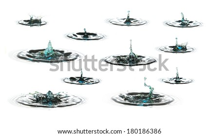 water drop falling in water - stock photo