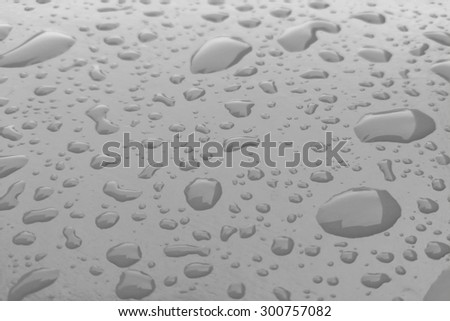 water drop on body of car for background - stock photo