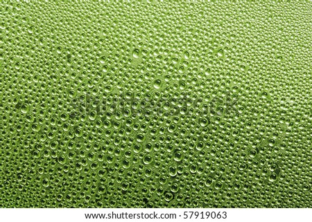 Water drop on glass in Green - stock photo