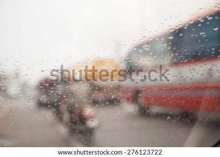 water drop  rain   on road blur background - stock photo