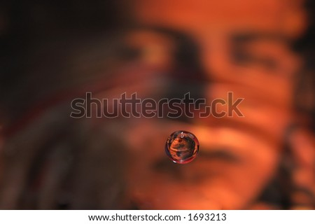 Water Drop with a out of focus woman behind - stock photo
