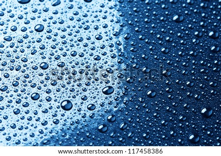 water droplets are blue. abstract background - stock photo