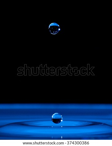 Water droplets frozen in space. - stock photo