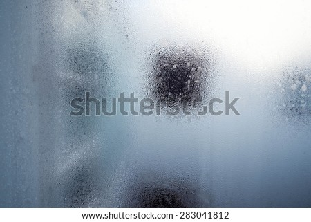 Water droplets of hazy on glass in the morning  - stock photo